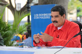 "Venezuela's President Nicolas Maduro speaks during his weekly broadcast ""Los Domingos con Maduro"" (The Sundays with Maduro) in Caracas, July 23, 2017."