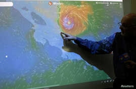 An official of the National Institute of Meteorology shows on a screen the advance of the Hurricane Otto in San Jose, Costa Rica, Nov. 24, 2016.