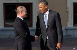 Russia's President Vladimir Putin, left, shakes hands with U.S. President Barack Obama during arrivals for the G-20 summit at the Konstantin Palace in St. Petersburg, Russia, Sept. 5, 2013.
