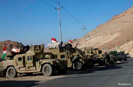 Military vehicles of Kurdish security forces are seen at Mount Sinjar, in the town of Sinjar, Iraq, Dec. 21, 2014.