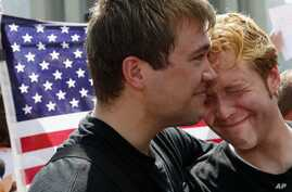 Michael Knaapen (L) and his husband John Becker embrace outside the Supreme Court after the court cleared the way for same-sex marriage in California by holding that defenders of California's gay marriage ban did not have the right to appeal lower co