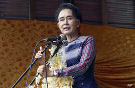 "Myanmar opposition leader Aung San Suu Kyi speaks during her ""Election Awareness Tour"" in Ho-Pong township in Pa-O self-administrative zone, southern Shan State, Myanmar, Sunday, Sept. 6 2015."