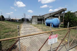 A gate at the U.S. Oil Recovery Superfund site, Sept. 14, 2017, in Pasadena, Texas, where three tanks once used to store toxic waste were flooded during Hurricane Harvey.
