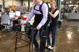 Patrick Wensing tests out an Ekso Bionics exoskeleton in his lab at the University of Notre Dame. He and his team are working to make the machines more intuitive. (Photo: Notre Dame)