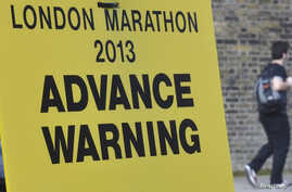 A road closure sign is seen placed along The Mall, the location for the London Marathon finish line, in central London, April 16, 2013.