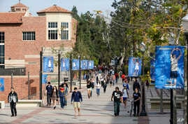 FILE - Students make their way across the UCLA campus in Los Angeles, Feb. 26, 2015. University of California officials have proposed limiting nonresident enrollment all undergraduate students, in an effort to prioritize in-state applicants.