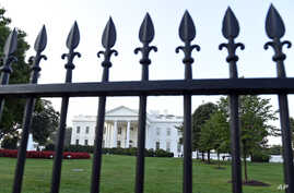 The White House is framed with the fence on the North side of the White House in Washington, Sept. 20, 2014.
