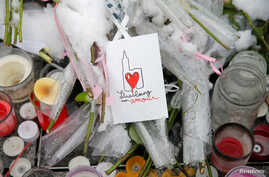 """A drawing representing Strasbourg's cathedral is seen at an improvised memorial in tribute to the victims of December 11 attack during a ceremony in Strasbourg, France, Dec. 16, 2018. The sign reads """"Strasbourg my love."""""""
