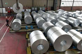 FILE - Steel coils are stored at the Thyssenkrupp steel factory in Duisburg, Germany. Duisburg is the biggest steel producer site in Europe, April 27, 2018. Many small companies in the United States can expect to pay more for steel and aluminum follo