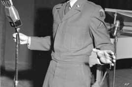 "Pfc. Vic Damone, former radio, TV and stage singer, presently assigned to the 7729 Special Services Group, made an appearance at the European premier of a new film musical ""Rich, Young, and Pretty"" at the American Theater in Nuremberg, Dec. 7, 1951."