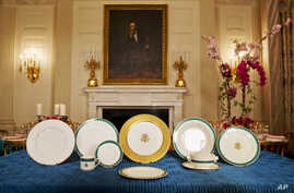 The White House displays the china set for Tuesday's State Dinner hosted by President Barack Obama for Japanese Prime Minister Shinzo Abe, in the State Dining Room of the White House, in Washington, April 27, 2015.