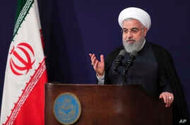 In this photo released by the official website of the office of the Iranian Presidency, President Hassan Rouhani addresses the nation in a televised speech in Tehran, Aug. 6, 2018.
