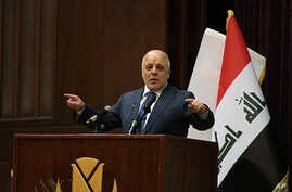 Iraq Prime Minister Haider al-Abadi  gestures, during a press conference, in Baghdad, Iraq, Saturday, Dec. 9, 2017. Iraq said Saturday that its war on the so-called Islamic State is over after more than three years of combat operations drove the extr...