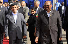 Iran's President Mahmoud Ahmadinejad (L) walks with Sudan's President Omar Hassan al-Bashir after talks focused on boosting political and economic ties between their countries, at the Khartoum international airport September 26, 2011.