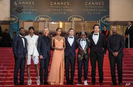 John Washington, from (L), Damaris Lewis, Jasper Paakkonen, Laura Harrier, Topher Grace, Spike Lee, Adam Driver, Corey Hawkins at the 'BlacKkKlansman' premiere at the 71st international film festival, Cannes, France, May 14, 2018.