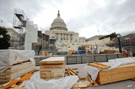 Building materials are stacked as construction continues on the inaugural platform in preparation for the swearing-in ceremonies for President-elect Donald Trump on the Capitol steps in Washington, Dec. 8, 2016. Trump will be sworn in as president on
