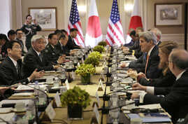 Japanese Foreign Minister Fumio Kishida, left, and Defense Minister Gen Nakatani, second from left, attend a meeting with U.S. Secretary of State John Kerry, third from right, and Secretary of Defense Ashton Carter, not visible, in New York, April 27