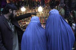 Afghan women shop at a market ahead of the upcoming Eid al-Adha, or the Feast of the Sacrifice in Jalalabad east of Kabul, Afghanistan, October 24, 2012.