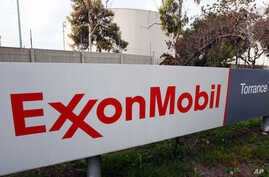 FILE - A sign for the ExxonMobil Torerance Refinery in Torrance, California, Jan. 30, 2012
