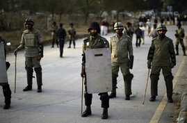 Pakistani rangers stand guard as supporters of cleric Tahir-ul Qadri attend a rally in Islamabad, Jan. 14, 2013.
