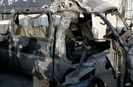 Photo released by Syria's official news agency shows damaged vehicle at scene of an attack, Damascus, Nov. 7, 2012.