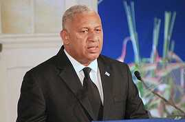 Fiji's leader Frank Bainimarama comments on how the country's constitution enshrines principles including an independent judiciary, a secular state, and a range of civil, political, and socio-economic rights, during a speech in Suva, Sept. 6, 2013.