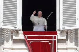 Pope Francis recites the Angelus noon prayer from the window of his studio overlooking St.Peter's Square, at the Vatican, Sunday, Sept. 2, 2018.
