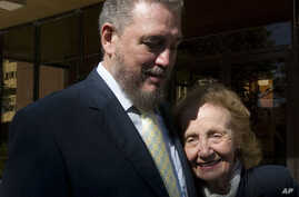 Fidel Castro Diaz-Balart, son of Cuba's former President Fidel Castro and senior researcher and professor of the Cuban Academy of Sciences meets his mother, Mirta Diaz-Balart, during the opening session of a scientific seminar in Havana, Nov. 14, 200