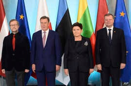 Szydlo and Lithuania Saulius Skvernelis, right, pose for a photo prior to talks in Warsaw, Poland, Sept. 5, 2017.