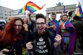 People celebrate Germany's parliament legalizing same-sex marriage in front of the Brandenburg Gate in Berlin, Germany June 30, 2017.