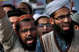 Pakistani students of Islamic seminaries chant slogans during a rally in support of blasphemy laws, in Islamabad, Pakistan, March 8, 2017. This week three bloggers were ordered held while blasphemy charges are being investigated.