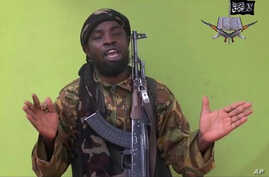File photo taken from video by Nigeria's Boko Haram terrorist network, shows their leader Abubakar Shekau speaking to the camera.
