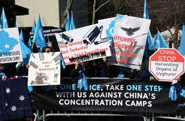 Uighurs and their supporters rally across the street from United Nations headquarters in New York, March 15, 2018, to protest a sweeping Chinese surveillance and security campaign that has sent thousands of their people into detention and political i