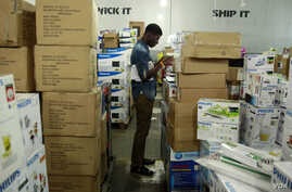 A staff member takes stock of goods at the warehouse of Konga online shopping company in Ilupeju district in Nigeria's commercial capital Lagos, Sept. 13, 2013.
