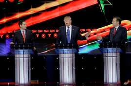 Republican presidential candidate, businessman Donald Trump, center, reacts to Republican presidential candidate, Sen. Ted Cruz, R-Texas, right, as Republican presidential candidate, Sen. Marco Rubio, R-Fla., looks on during a Republican presidential