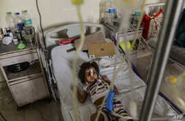 In this photo taken on Sept. 15, 2015 Indian patient, Aishwarya Gupta (4) lies on a bed in the dengue ward of a government hospital in New Delhi.