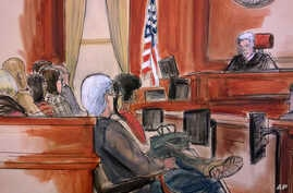 In this courtroom drawing, Judge Richard Berman addresses the jury at the end of the day's deliberations in the corruption trial of Halkbank executive Mehmet Hakan Atilla, Dec. 22, 2017.