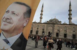 A poster of Turkish Prime Minister Recep Tayyip Erdogan on an election billboard of his Justice and Development Party in Istanbul, March 27, 2014.