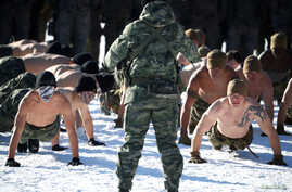 FILE - South Korean and U.S. Marines take part in a winter military drill in Pyeongchang, South Korea, Dec. 19, 2017.