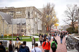 FILE - Students walk through the campus of Temple University, which has an enrollment of more than a 38,000 and offers 464 academic degree programs, in Philadelphia, Pennsylvania, Dec. 1, 2016.