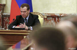 """FILE - Russian Prime Minister Dmitry Medvedev chairs a meeting with members of the government in Moscow, Russia, June 29, 2017. On Thursday, Medvedev announced sanctions against Ukrainian individuals and entities """"to counter Ukraine's unfriendly acti"""