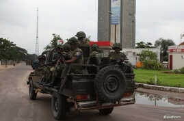 Congolese soldiers in their truck toward the state television headquarters in the capital Kinshasa, Democratic Republic of Congo, Dec. 30, 2013.