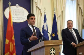 Macedonian Foreign Minister Nikola Dimitrov, left, speaks next to Greek Foreign Minister Nikos Kotzias during a news conference after their meeting in Athens, June 14, 2017.