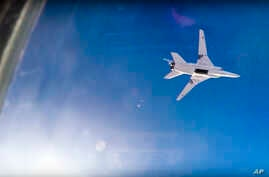 In this frame grab from video provided by Russian Defence Ministry press service, Russian long range bomber Tu-22M3 flies during an air strike over Aleppo region of Syria on Aug. 16, 2016.
