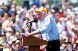 Democratic presidential candidate Sen. Bernie Sanders speaks during a campaign rally at the Cubberley Community Center, June 1, 2016, in Palo Alto, California. Sanders has joined Clinton in attacks against Republican presumptive nominee Donald Trump.