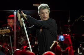 FILE - Bon Jovi performs with his band in Miami Beach, Florida.