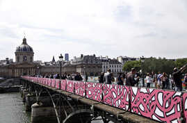 Temporary panels covered of graffiti are seen on the Pont des Arts bridge, in Paris, June 10, 2015.