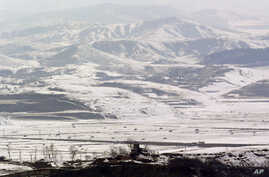 A North Korean military guard post in Kaepoong is viewed from the unification observation post near the border village of Panmunjom, north of Seoul, South Korea, February 13, 2013.