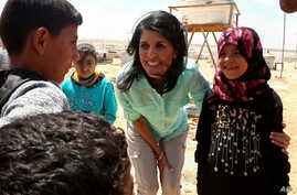 U.S. Ambassador to the United Nations Nikki Haley, speaks with Syrian refugee children, during a visit to the Zaatari Refugee Camp, Jordan, May 21, 2017.