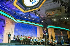 """Lucinda Storz of Rutland, Vermont, spells the word """"lacustrine"""" during the third round of the 88th annual Scripps National Spelling Bee at National Harbor, Maryland, May 27, 2015."""